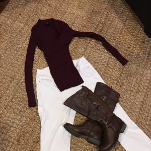 Fitted burgundy v-neck sweater.